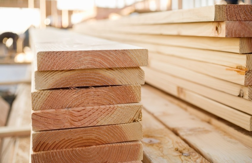 Stacked Lumber at a Building Site